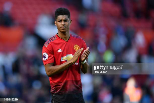Marcus Rashford of Manchester United looks dejected as he applauds the fans following his side's defeat during the Premier League match between...