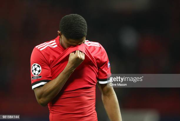Marcus Rashford of Manchester United looks dejected in defeat after the UEFA Champions League Round of 16 Second Leg match between Manchester United...