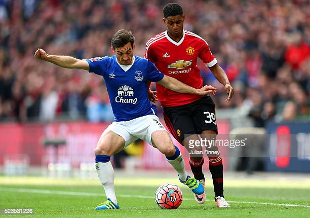 Marcus Rashford of Manchester United makes a challenge on Leighton Baines of Everton during The Emirates FA Cup semi final match between Everton and...