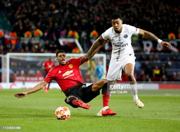 Marcus Rashford of Manchester United Presnel Kimpembe of PSG during the UEFA Champions League Round of 16 First Leg match between Manchester United...