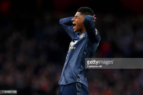 Marcus Rashford of Manchester United reacts after missing a freekick during the Premier League match between Arsenal FC and Manchester United at...