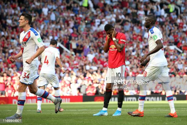 Marcus Rashford of Manchester United reacts after missing from the penalty spot during the Premier League match between Manchester United and Crystal...