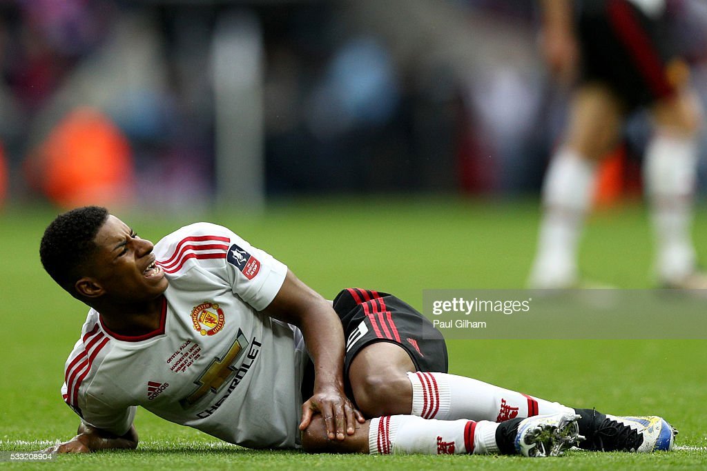 Marcus Rashford of Manchester United reacts as he lies on the pitch after picking up an injury during The Emirates FA Cup Final match between Manchester United and Crystal Palace at Wembley Stadium on May 21, 2016 in London, England.