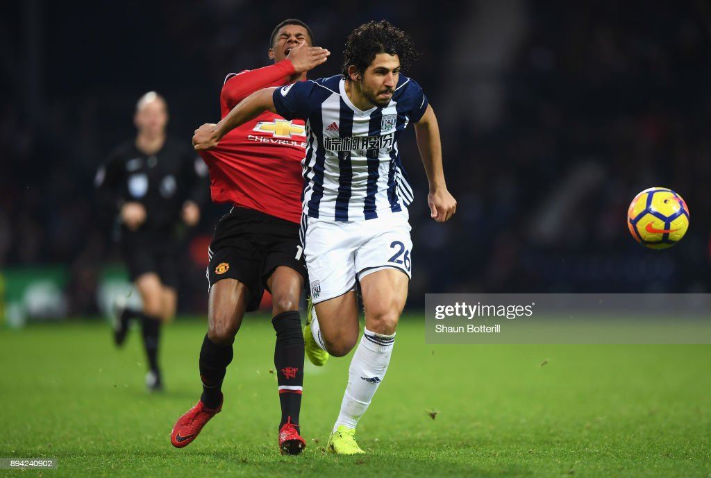 Marcus Rashford of Manchester United reacts to being caught in the face by Ahmed El-Sayed Hegazi of West Bromwich Albion as he runs away with the ball during the Premier League match between West Bromwich Albion and Manchester United at The Hawthorns on December 17, 2017 in West Bromwich, England.