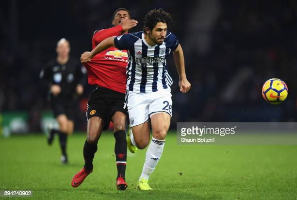 Marcus Rashford of Manchester United reacts to being caught in the face by Ahmed ElSayed Hegazi of West Bromwich Albion as he runs away with the ball...