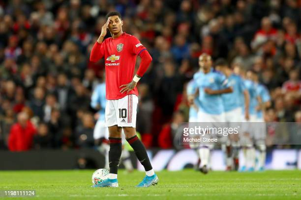 Marcus Rashford of Manchester United reacts to Manchester City scoring there third goal during the Carabao Cup Semi Final match between Manchester...