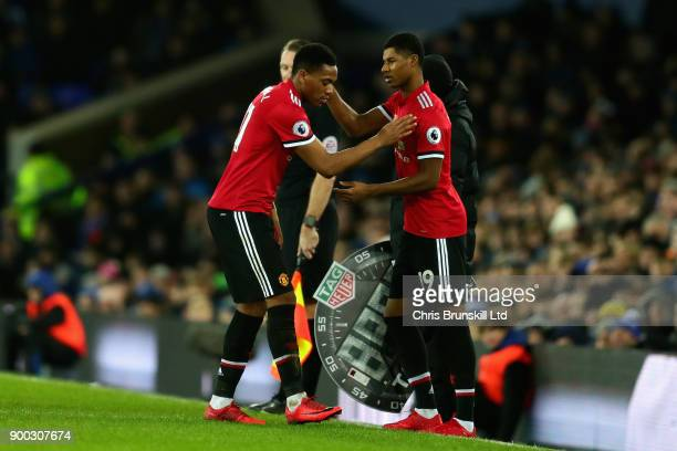 Marcus Rashford of Manchester United replaces Anthony Martial of Manchester United as a substitute during the Premier League match between Everton...