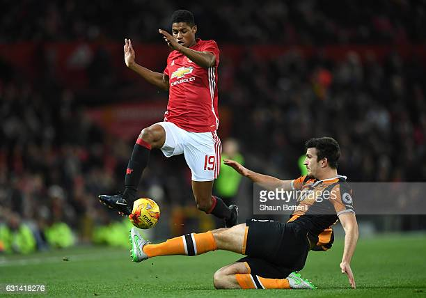 Marcus Rashford of Manchester United rides a tackle from Harry Maguire of Hull City during the EFL Cup SemiFinal First Leg match between Manchester...