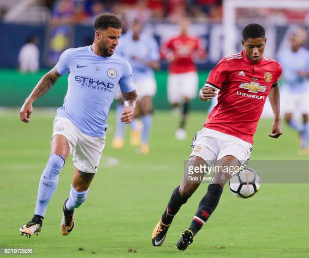 Marcus Rashford of Manchester United runs down the ball as Kyle Walker of Manchester City pursues at NRG Stadium on July 20 2017 in Houston Texas