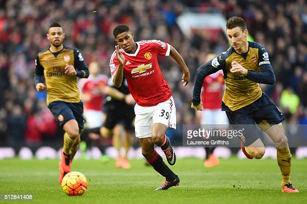 Marcus Rashford of Manchester United runs for the ball with Laurent Koscielny of Arsenal during the Barclays Premier League match between Manchester...