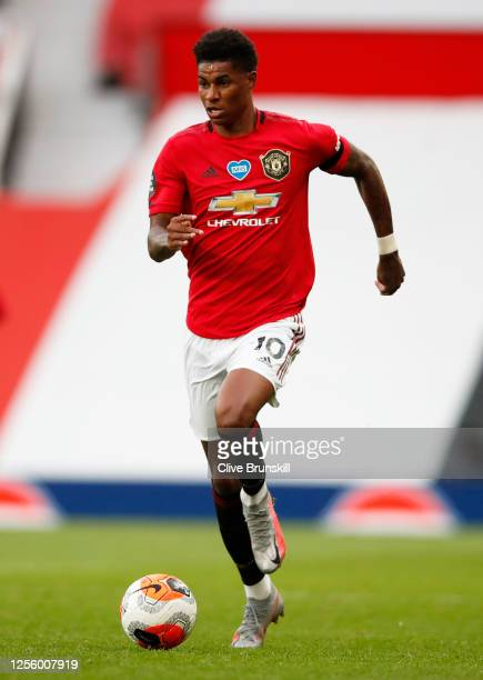 Marcus Rashford of Manchester United runs with the ball during the Premier League match between Manchester United and Southampton FC at Old Trafford...