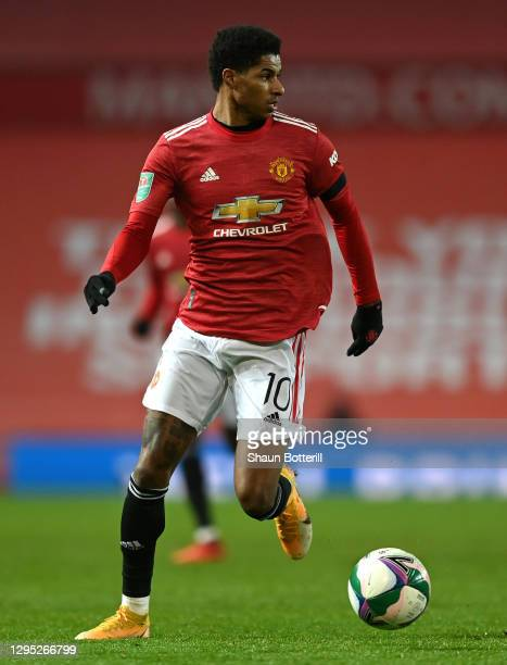 Marcus Rashford of Manchester United runs with the ball during the Carabao Cup Semi Final match between Manchester United and Manchester City at Old...