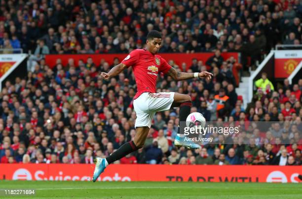 Marcus Rashford of Manchester United s cores his sides first goal during the Premier League match between Manchester United and Liverpool FC at Old...