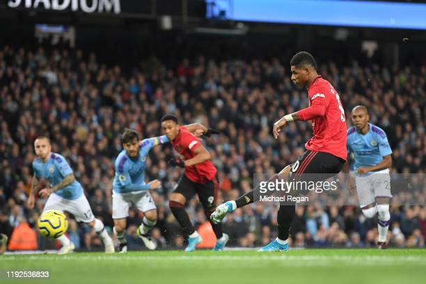 Marcus Rashford of Manchester United scores a penalty to make it 10 during the Premier League match between Manchester City and Manchester United at...