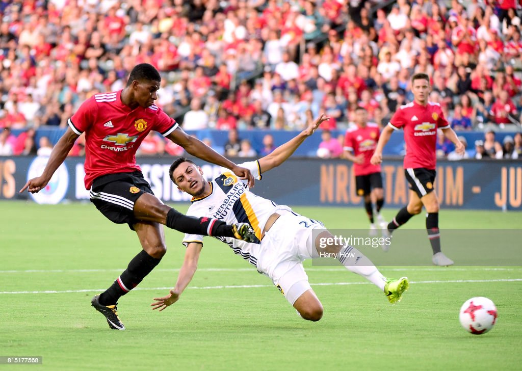 Marcus Rashford #19 of Manchester United scores his second goal of the game past Hugo Arellano #21 of Los Angeles Galaxy to take a 2-0 lead during the first half at StubHub Center on July 15, 2017 in Carson, California.
