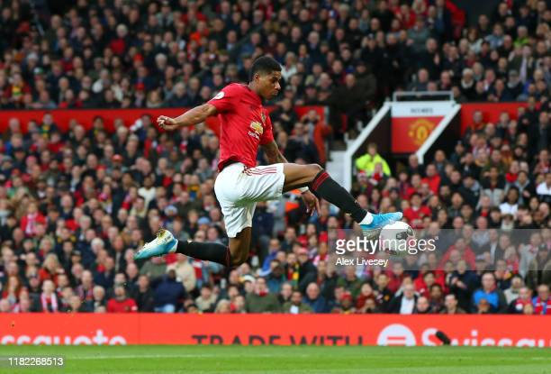 Marcus Rashford of Manchester United scores his sides first goal during the Premier League match between Manchester United and Liverpool FC at Old...