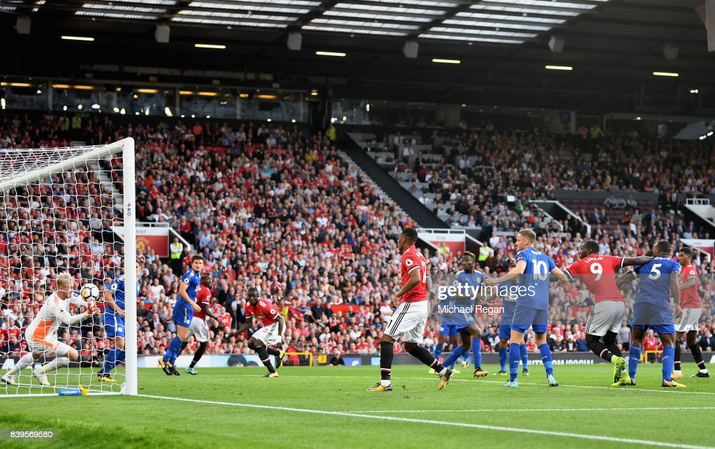 Marcus Rashford of Manchester United scores his sides first goal during the Premier League match between Manchester United and Leicester City at Old Trafford on August 26, 2017 in Manchester, England.