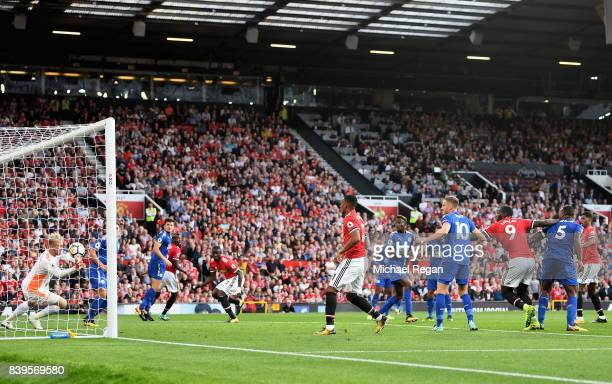 Marcus Rashford of Manchester United scores his sides first goal during the Premier League match between Manchester United and Leicester City at Old...