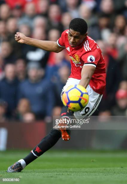 Marcus Rashford of Manchester United scores his side's first goal during the Premier League match between Manchester United and Liverpool at Old...
