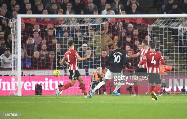 Marcus Rashford of Manchester United scores his sides third goal during the Premier League match between Sheffield United and Manchester United at...