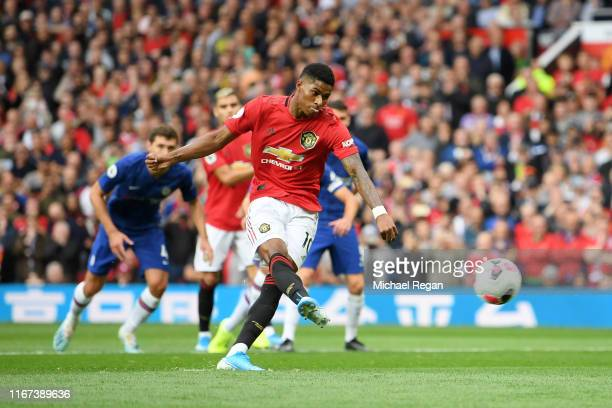 Marcus Rashford of Manchester United scores his team's first goal from the penalty spot during the Premier League match between Manchester United and...