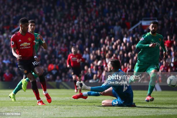 Marcus Rashford of Manchester United scores his team's first goal past Ben Foster of Watford during the Premier League match between Manchester...