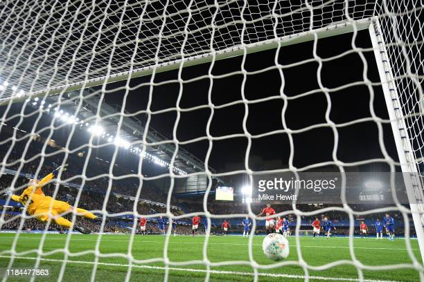 Marcus Rashford of Manchester United scores his team's first goal past Willy Caballero of Chelsea from the penalty spot during the Carabao Cup Round...