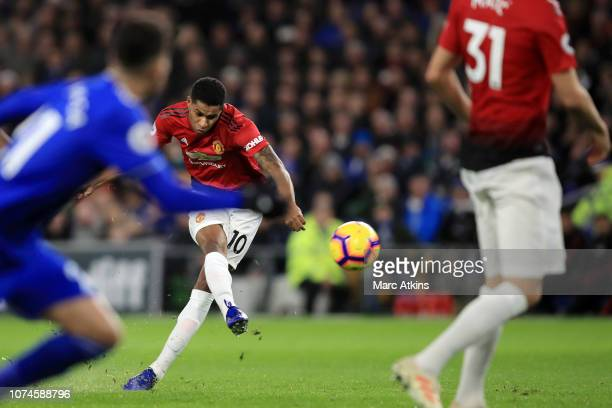 Marcus Rashford of Manchester United scores his team's first goal during the Premier League match between Cardiff City and Manchester United at...
