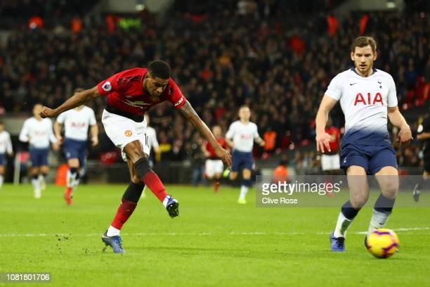 Marcus Rashford of Manchester United scores his team's first goal during the Premier League match between Tottenham Hotspur and Manchester United at...