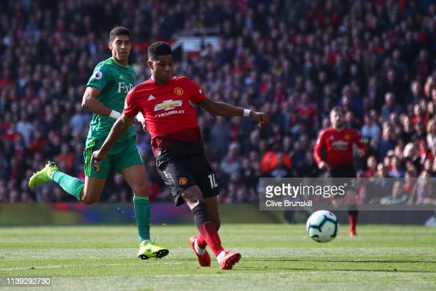 Marcus Rashford of Manchester United scores his team's first goal during the Premier League match between Manchester United and Watford FC at Old...