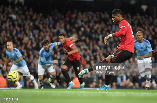 Marcus Rashford of Manchester United scores his team's first goal during the Premier League match between Manchester City and Manchester United at...