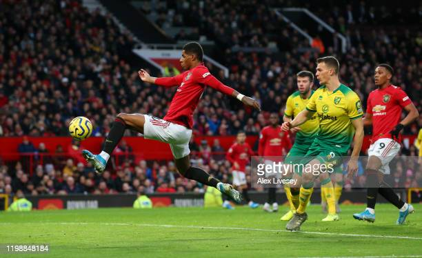 Marcus Rashford of Manchester United scores his team's first goal during the Premier League match between Manchester United and Norwich City at Old...
