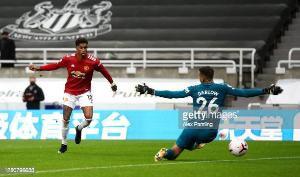 Marcus Rashford of Manchester United scores his team's fourth goal past Karl Darlow of Newcastle United during the Premier League match between...