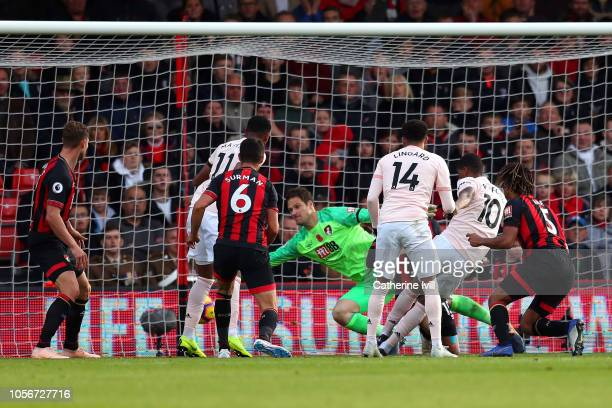 Marcus Rashford of Manchester United scores his team's second goal past Asmir Begovic of AFC Bournemouth during the Premier League match between AFC...