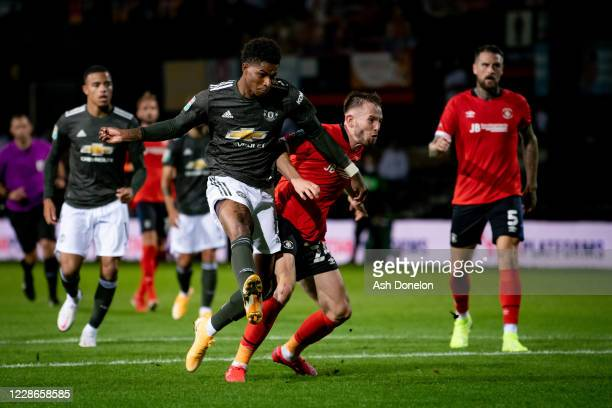 Marcus Rashford of Manchester United scores his teams second goal during the Carabao Cup Third Round match between Luton Town and Manchester United...