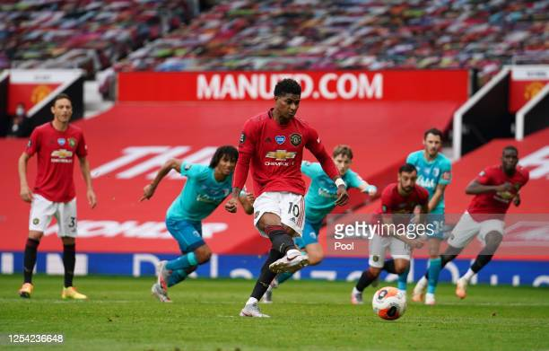 Marcus Rashford of Manchester United scores his team's second goal from the penalty spot during the Premier League match between Manchester United...