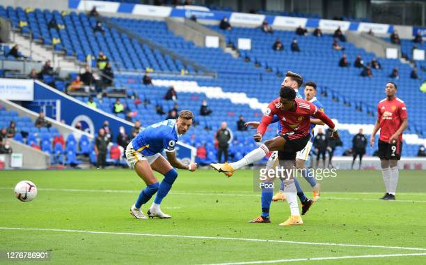 Marcus Rashford of Manchester United scores his team's second goal during the Premier League match between Brighton & Hove Albion and Manchester...