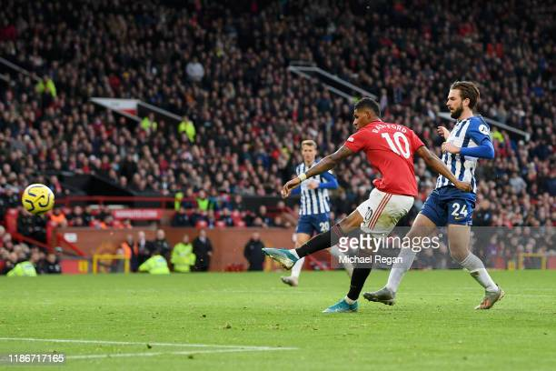 Marcus Rashford of Manchester United scores his team's third goal during the Premier League match between Manchester United and Brighton Hove Albion...
