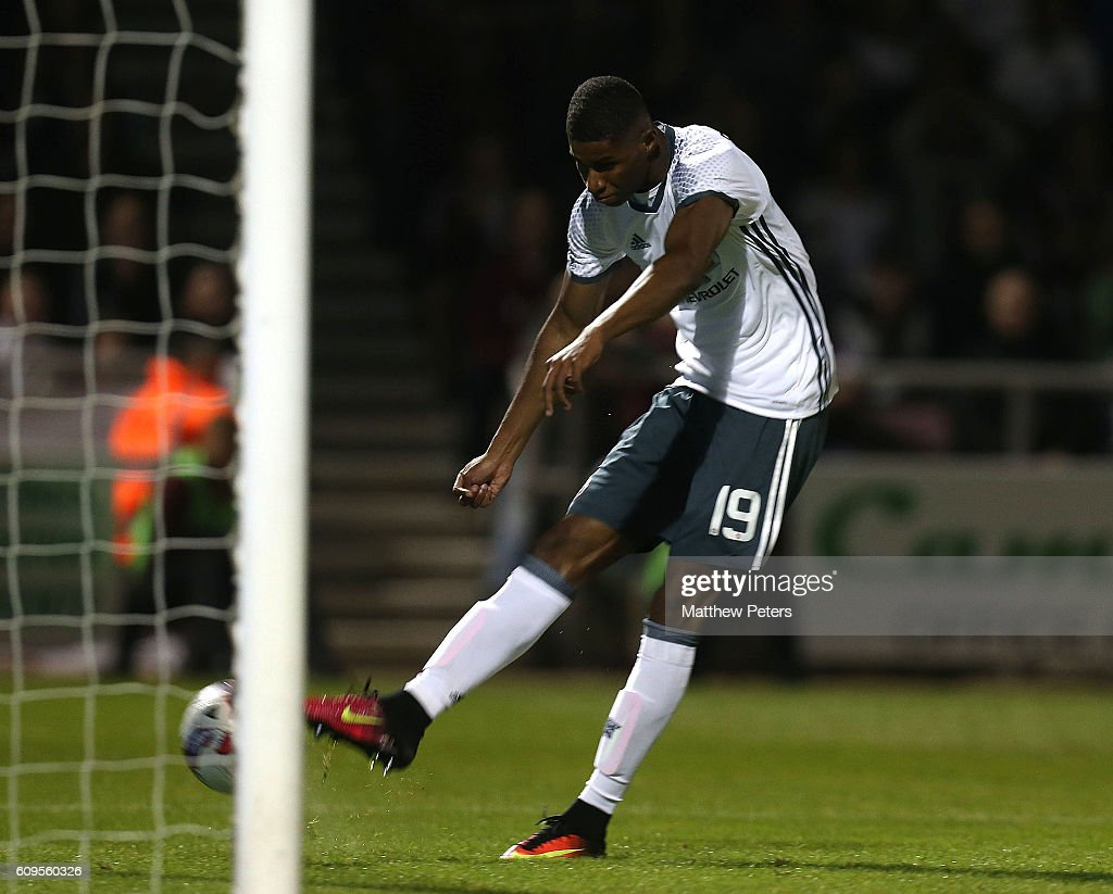 Marcus Rashford of Manchester United scores his team's third goal during the EFL Cup Third Round match between Northampton Town and Manchester United at Sixfields on September 21, 2016 in Northampton, England.