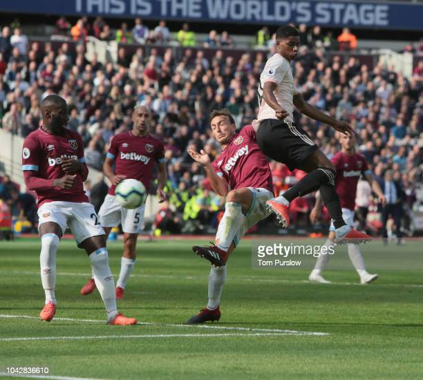 Marcus Rashford of Manchester United scores their first goal during the Premier League match between West Ham United and Manchester United at London...