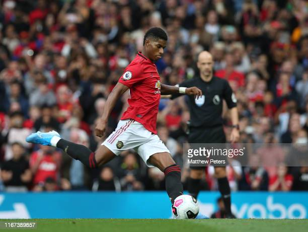 Marcus Rashford of Manchester United scores their first goal during the Premier League match between Manchester United and Chelsea FC at Old Trafford...