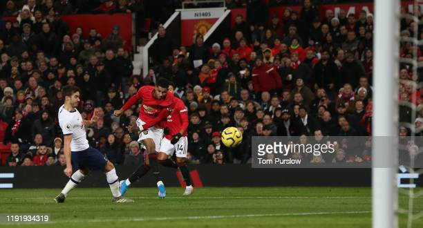 Marcus Rashford of Manchester United scores their first goal during the Premier League match between Manchester United and Tottenham Hotspur at Old...