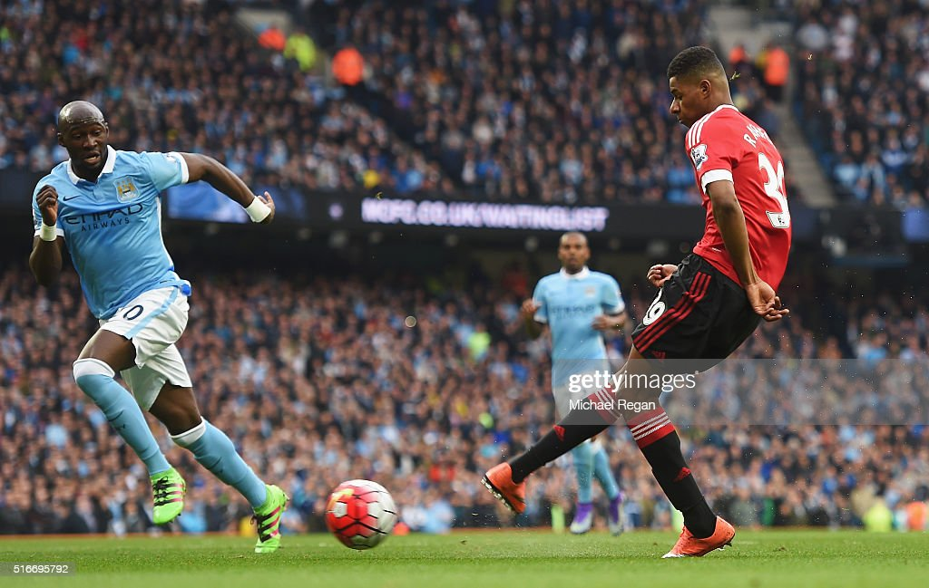 Marcus Rashford of Manchester United scores their first goal during the Barclays Premier League match between Manchester City and Manchester United at Etihad Stadium on March 20, 2016 in Manchester, United Kingdom.