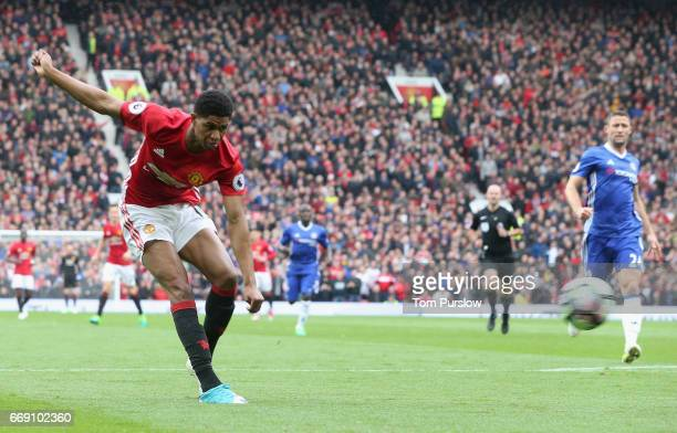 Marcus Rashford of Manchester United scores their first goal during the Premier League match between Manchester United and Chelsea at Old Trafford on...