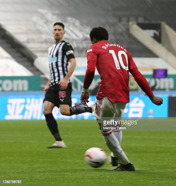 Marcus Rashford of Manchester United scores their fourth goal during the Premier League match between Newcastle United and Manchester United at St...