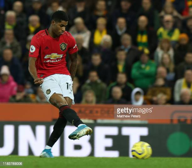 Marcus Rashford of Manchester United scores their second goal during the Premier League match between Norwich City and Manchester United at Carrow...