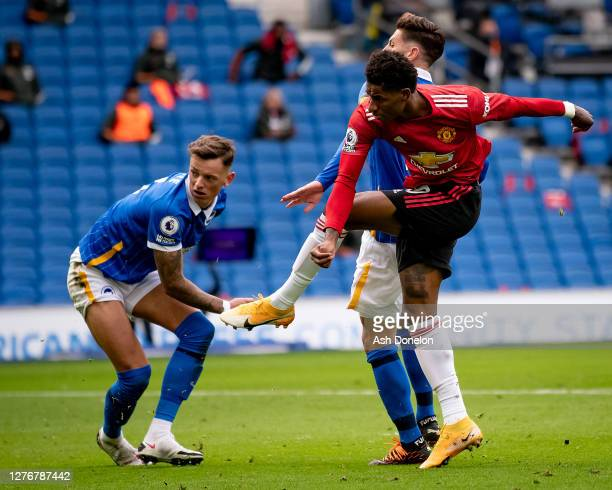 Marcus Rashford of Manchester United scores their second goal during the Premier League match between Brighton & Hove Albion and Manchester United at...