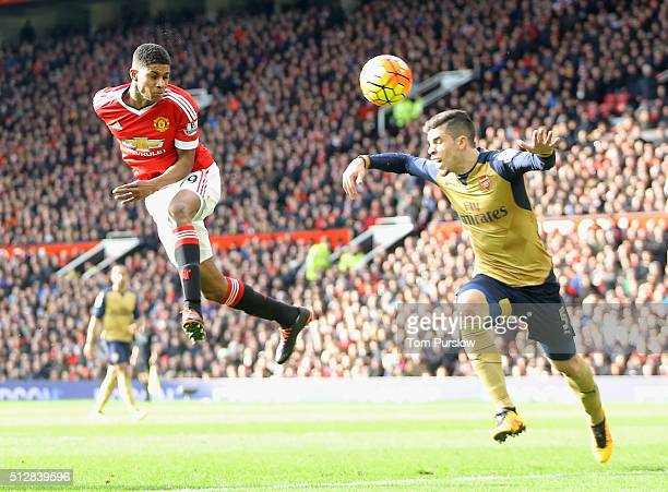Marcus Rashford of Manchester United scores their second goal during the Barclays Premier League match between Manchester United and Arsenal at Old...