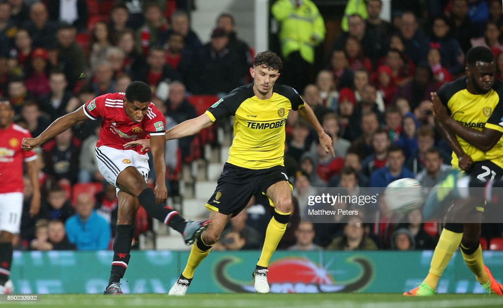 Marcus Rashford of Manchester United scores their second goal during the Carabao Cup Third Round between Manchester United and Burton Albion at Old Trafford on September 20, 2017 in Manchester, England.