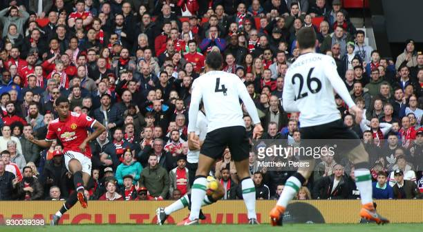Marcus Rashford of Manchester United scores their second goal during the Premier League match between Manchester United and Liverpool at Old Trafford...
